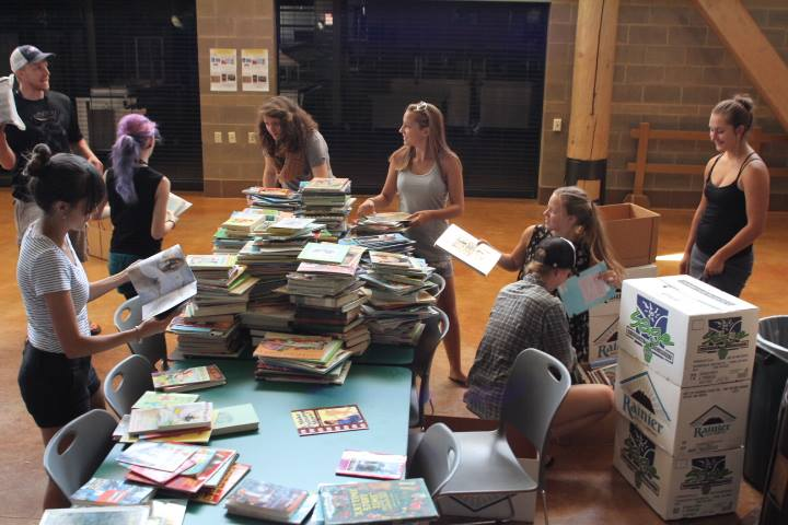 Students packing up their boxes so these books can be part of the new library being constructed.