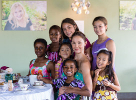 Actress, Ashley Judd, featured in A Path Appears with young girls from the documentary.